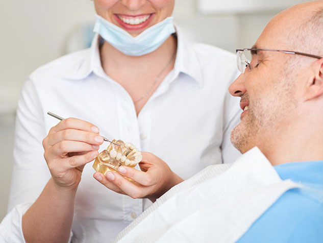 dentist explaining cosmetic dentistry procedure to patient