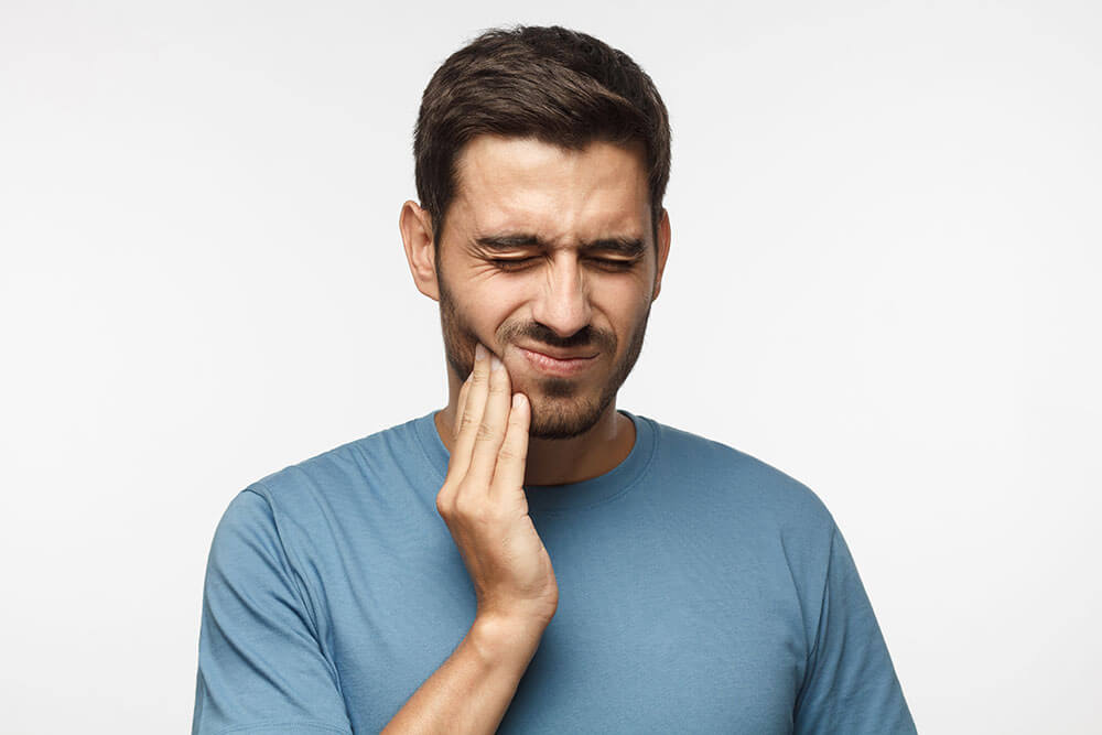 Man in pain do to TMJ disorder