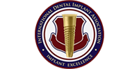 International Dental Implant Association logo in blue, red, and gold
